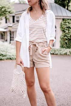 Khaki shorts and a white button down for a beachy summer outfit | beach outfit | khaki shorts beach outfit | khaki shorts outfit | 3 ways to wear khaki shorts | how to make khaki shorts look cute | beige striped top | casual summer outfit | casual beach outfit | net bag outfit | neutral summer outfit | casual chic summer outfit | casual summer outfit | chic summer outfit