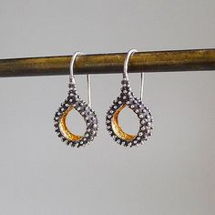 Granule Drops earrings by dmdmetal  ||  Oxidized silver drop style earring with high polished granules. 22k vermeil hammered texture interior.  ||  gold and silver, silver drops, 22k, 22k vermeil, hammered textures, shepards hook  ||  $125.00