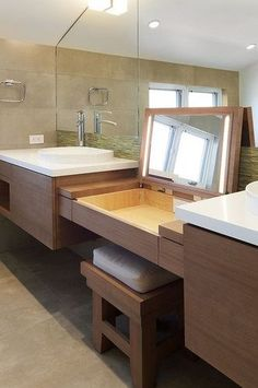 sink vanity flows into integrated dressing table (minus the lights & flip up mirror) & bench; wall-mounted OR on furniture legs so vanity NOT sitting right on the dark wood-look tile floor