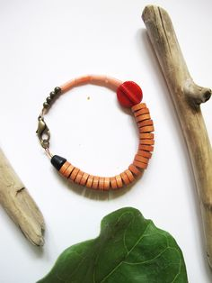 BRACELET #509 | by dulldiamond  |  $34  |  wood and red  |  mix of glass, wood, coral and brass beads  |  strung on metallic flex wire w/ brass clasp