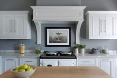 8 Buckland cooker hood and contrasting Carrera marble and oak worktops