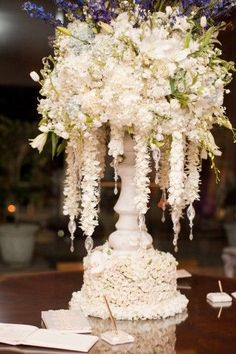 Beautiful sign in table  or escort card table arrangement <3