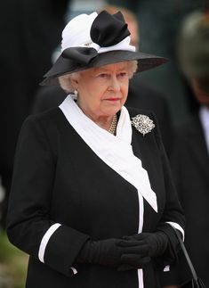 October 2008. Wearing The Richmond Brooch.   The Queen inherited the brooch when Queen Mary died, in 1953. She wore it during her post-Coronation Commonwealth tour, but then seems to have put it away. Only in her later years has it appeared again, worn for evening events and a few special day engagements. She has worn it both with and without the bottom pearl pendant.