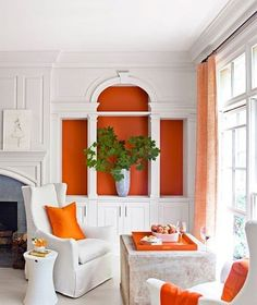 How to Style Your Bookshelves So They're Always Ready for a Close-Up - Bookshelf Decorating Ideas – Unique Bookshelf Decor Ideas – House Beautiful. Orange Paint by Pr - Atlanta Homes, House Design, Bookshelf Decor, Orange Decor, Orange House, Beautiful Homes, Home Decor, House Interior, Interior Design