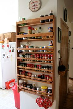 I LOVE this freakin spice rack! Except I would either need the spices in uniform containers or mount something similar to the back of a pantry door. Because digging through cabinets and knocking most of them down just to find one is just frustrating!