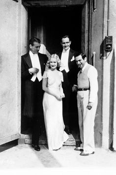 Gary Cooper, Miriam Hopkins, Fredric March, and director Ernst Lubitsch on the set of Design for Living (1933)