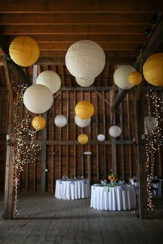Yellow paper lanterns and lighted branches for the rehearsal