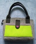 Smaller gray with green felt bag. Nice and cheaper