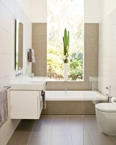 Clever ideas on making the most of a small space for a bathroom, clear frameless glass, sliding doors on vanity - great ideas see ;  www.bhg.com.au  Small bathroom ideas  - Better Homes and Gardens - Yahoo!7