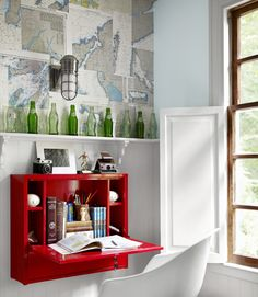"""This space-saving, schoolhouse-red desk folds up when not in use and can be repurposed in multiple ways: as a cocktail bar, craft station, or, if you equip it with a mirror, a vanity. For a similar look, try the """"wallbanger"""" shelf at Bobby Berk Home ($399; enter code CL10 for a 10% reader discount). RELATED: 26 Great Home Office Ideas   - HouseBeautiful.com"""
