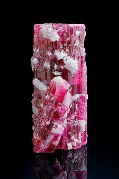 Rubellite and lepidolite. By e-rocks.com