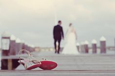 One of my favorite photos from a beach wedding at the Vineyard Haven Yacht Club on Martha's Vineyard... love this photo of the bride and groom walking down the dock, with the bride's pink soled shoes in the foreground!  #vineyardhavenwedding #marthasvineyard