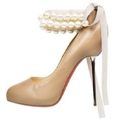 Louboutins via Weddbook. The pearls and bow = I die! What a gorgeous wedding shoe. Don't really like the nude or the too-high metal heel, though. Source model name.