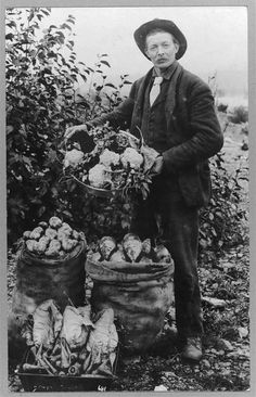 This is a picture of a 1920's farmer with his crop. He must have a plentiful harvest.