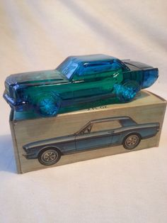 Vintage Avon '64 Mustang Collectible Car Bottle/Decanter, Full w/ Tai Winds After Shave, 2 oz. Bottle is in excellent condition. Original box slightly worn/aged. See all the photos for details