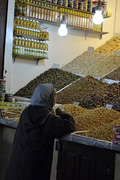 MARRAKESH - buying olives in a medina shop