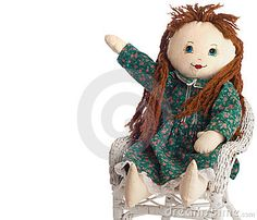 Homemade Cloth Doll Points Toward Copy Space by Candace Hartley, via Dreamstime