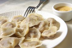 Pelmeni (Russia) Minced meat like pork, lamb or beef mixed with spices like black pepper are filled into small dumplings made from flour, eggs and water.