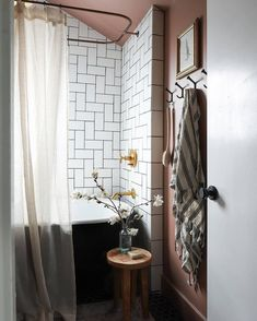 Warm mocha walls contrast beautifully against this shower's crisp white tile for the ultimate cozy vibe. Design + Photo by @ispydiy.  Tile featured:Imperial Brite White 4x8in. Loft Bathroom, Upstairs Bathrooms, Master Bathroom, I Spy Diy, The Tile Shop, Chair Makeover, White Tiles, Kitchen On A Budget, Color Tile
