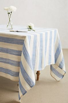 Awning Stripe Tablecloth - anthropologie.com. I would buy or block print the fabric before I spent $118 on a table cloth but I like the look.