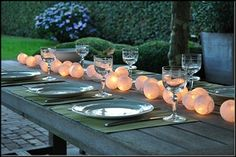 fun centerpiece orbs with lights en masse down center of table