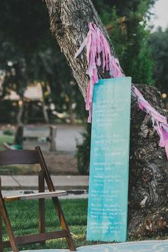 Giant Menu painted on a colorful board | Event Design - Sitting in a Tree | See Wedding on SMP: http://www.stylemepretty.com/2013/11/19/santa-ynez-wedding-from-sitting-in-a-tree-events | Photo - Studio Castillero