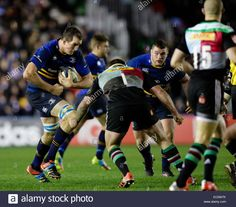 Download this stock image: London, UK. 07th Dec, 2014. European Rugby Champions Cup. Harlequins versus Leinster. Leinster second row Devin Toner prepares for the tackle of Harlequins loosehead prop Joe Marler (c) Credit:  Action Plus Sports/Alamy Live News - EC0W7K from Alamy's library of millions of high resolution stock photos, illustrations and vectors.
