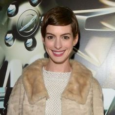 Actress Anne Hathaway wore her short hair in a sleek, side-swept style with a retro outfit at the Vanity Fair and the Chrysler brand Celebration of Les Misérables in support of The Los Angeles Fund for Public Education at Eveleigh restaurant on 20 February 2013 in Los Angeles, California.