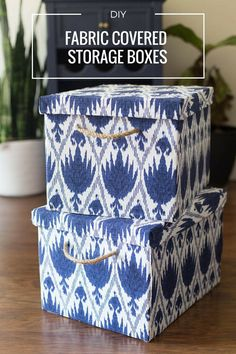 Don't throw old boxes out! Upcycle them into stylish storage. Glue fabric to the outside to create pretty fabric covered storage boxes.