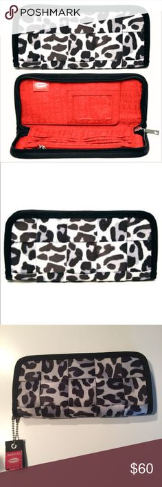 HTF Harvey's Seatbelt Ice Leopard Clutch Wallet EUC. Super hard to find! Harness your money from financial collisions with Harveys safety inspired wallet. Made of bona fide seatbelts. Holds your credit cards, currency and identification. Zip around closure. Can even fit your phone! Interior with full length currency compartment, credit card slots and identification window. Dimensions 9 1/2 wide x 1 3/4 deep x 4 1/2 high. Made in the U.S.A. Harvey's Seatbelt Bags Bags Wallets