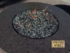 "Coffee table like granite top with ""fire rocks"" heated from a propane source for the patio"