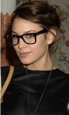 dc1e50b0c75 Alexa Chung looks geek chic with a frame from the Ray Ban optical  collection. The tortoise-colored frame is the eyeglass version of the  famous Wayfarer.