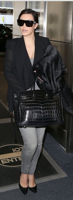 Kim Kardashian: Sunglasses – Celine    Purse – Hermes    Jacket – Helmut Lang    Jeans – Bleulab