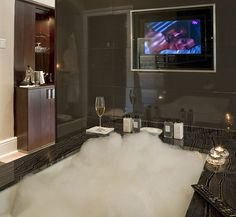 Seriously?! A bubble bath, liquor cabinet, flat screened tv and candles?!?! I dont think i would EVER get out!!