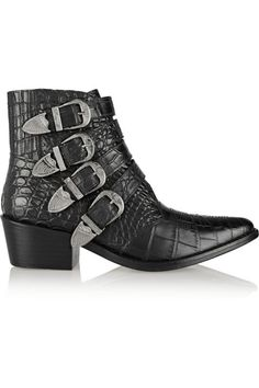Saddle up in this rocker version of a Western shoe. The traditional cowboy style is modernized with a faux animal skin texture, Cuban heel and stand-out silver buckles. Yeehaw!Toga Pulla Croc-Effect Leather Ankle Boots, $445, farfetch.com.