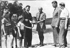 Crown Princess Märtha (right) with her three children, Princess Ragnhild, Princess Astrid and Prince Harald (our present king) at the dedication of the ship's bell from a Norwegian tanker who shipped 200,000 tons of gasoline from the US to England, in recognition of how lieutenant colonel Ole Reistad (centre), founder of Little Norway (the training school for Norwegian pilots in Toronto, Canada, 1941-45) helped to make good use of the gasoline. Maud Of Wales, Norwegian Royalty, Training School, Three Kids, World War Two, Denmark, Norway, Two By Two, England