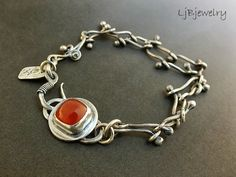 Handmade Jewelry by LjB: bracelet using balled up wire technique to assemble the links together...