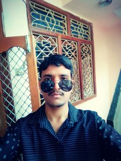 Another pic of selfie by author with different style way of glasses weared.