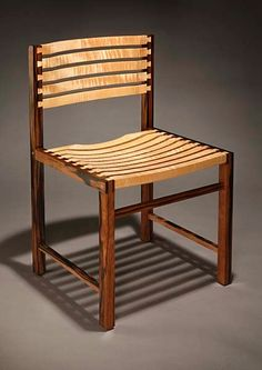 Chair made from Phillipine striped ebony and beautifully figured tiger maple. The seat and back slats are held in place by 28 dovetails. Size is 19 1/2 inches wide, 18 inches deep, 32 inches tall.