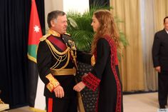 Jordanian King Abdullah II (L) is greeted by his daughter Princess Iman Bint Abdullah during the throne opening ceremony of the first ordinary session of the 17th Parliament on 03.11.13 in Amman, Jordan.