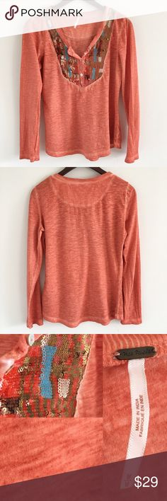 """Free People Sequined Orange Henley Top Sz M A boho top featuring long sleeves, sequins at the neckline, and functional buttons at the bust.  Stats (laying flat): Length: 25.5""""   Width (pit to pit): approx 19""""   Sleeve Length: approx 24""""  Pre-owned condition with some signs of wash & wear + light pilling   Care tags cut off   No trades Free People Tops Tees - Long Sleeve"""
