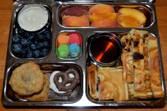Yogurt, blueberries, chocolate chip Landon's Lunches on Facebook:   cookies, yogurt & Chocolate covered pretzel, cut up waffles to dip in maple syrup, peaches, sour gummy candies :)  #planetbox #lunch #school #lunchbox