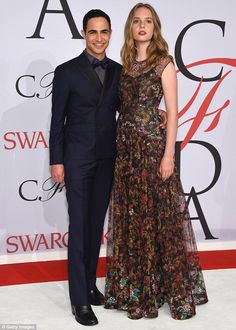 Plus one: Maya's heavily beaded dress was created by Zac Posen and she and the designer we...
