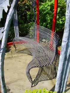Sprung curved bench made by Bartington Forge Ltd.
