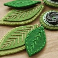 Embroidered leaves by SewSweetStitches. I think I could have a whole board of textile leaf arts & crafts.