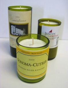recycled wine bottle candles - another idea for Robyn - see the how to cut glass bottle pin too! Old Wine Bottles, Recycled Wine Bottles, Bottles And Jars, Glass Bottles, Wine Bottle Candle Holder, Diy Candle Holders, Candle Set, Candle Gifts, Wine Bottle Candles