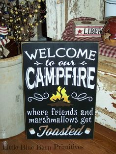 Welcome to our CAMPFIRE where friends and marshmallows get Toasted    •.,¸¸,:•:*♥*:•:,¸¸,:•:*♥*•.,¸¸,:•:*♥*:•:,¸¸,:••.,¸¸,:•:*♥*:•:,¸¸,:•:*♥*•.,¸¸,:•:*♥*:•:,¸¸,:•    Perfect for summer!!  <3    Hand painted Black with edges sanded & stained with antique white lettering on a pine board.  Measures ...