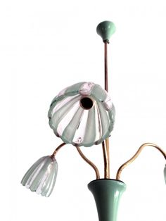 Italian original chandelier from the mid century. Brass structure with 3 arms. Green lacquered metal inserts. Lamp shades in Murano glass.    Dim.  h70 X ø50cm