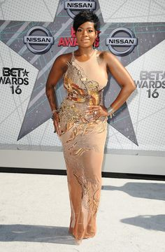 Fantasia | Fantasia Barrino celebrates a birthday today and in honor of the powerhouse vocalist we're taking a look at some of her most fabulous looks. From curve hugging sequins to full-on fringe moments, these are Fantasia's most flawless style moments.