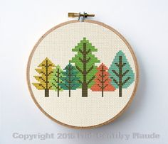 Complete cross stitch kit. Retro trees forest design in mid-century modern geometric style. The needlepoint kit includes an easy pattern, embroidery floss, a piece of 22 ct. aida fabric in an ivory color stretched into a 4 round wooden embroidery hoop; one blunt tip tapestry needle, and a sheet of simple cross stitching instructions. This kit includes everything you need to create and display this cute modern design. Easy, regular full cross stitches only. All of my designs are original and…